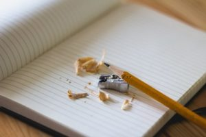sharpened pencil empty notebook